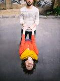 La fille tient le garçon de mains Photographie stock libre de droits