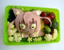 La fille un chat est faite de riz Kyaraben, bento Photographie stock