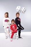 La fille vêtx la petite mode d'anniversaire de ballonnets de collection Photographie stock libre de droits