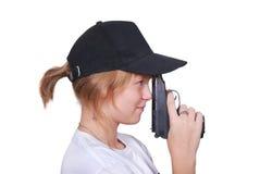 La fille vise un pistolet Photo libre de droits
