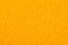 La fin du jaune a coloré le textile de feutre pour le fond Photo stock