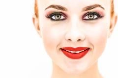 La fine della donna su che sembrano diritta e sorridere Immagini Stock Libere da Diritti