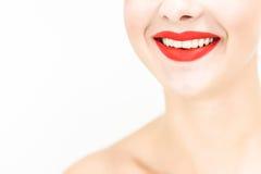 La fine della donna su che sembrano diritta e sorridere Immagine Stock