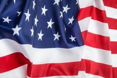 La fine di seta della bandiera americana su fondo decora Fotografia Stock Libera da Diritti