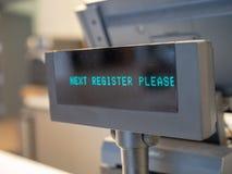 La fine su del registro seguente nota prego sulla macchina del registratore di cassa Fotografia Stock