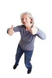 La fixation heureuse de dame âgée manie maladroitement vers le haut Photos stock