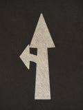 La flèche grunge signe la route Photos stock