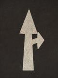 La flecha del Grunge firma el camino Fotos de archivo libres de regalías