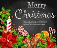 La fleur et le gui rouges de poinsettia de décoration de Noël avec le canela orange de tranche de pain d'épice de feuilles de ver Photos libres de droits