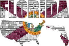 La Florida en una pared de ladrillo Imagen de archivo libre de regalías
