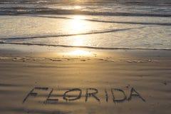 La Florida escrita en la playa arenosa Foto de archivo libre de regalías