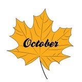 La foglia di acero gialla con l'iscrizione ottobre ha isolato Fotografia Stock Libera da Diritti