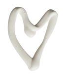 La forma del corazón hecha de la crema blanca en un fondo blanco, puede ser nosotros Foto de archivo