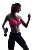 La forma fisica della donna pesa la siluetta di esercizi di allenamento Fotografia Stock