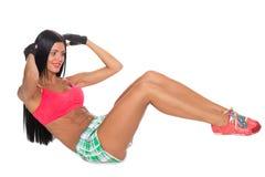 La forma fisica della giovane donna si esercita relativi alla ginnastica Immagine Stock Libera da Diritti