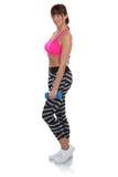 La forma fisica di allenamento mette in mostra la donna che sta con l'ente completo p delle teste di legno Fotografie Stock