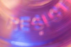 La forma girante astratta forma le lettere RESISTE A fotografia stock libera da diritti