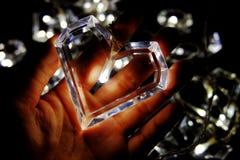 La forma ligera del corazón pone en la mano Foto de archivo libre de regalías