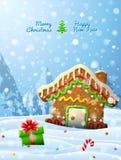 La formación de hielo adornada de la casa de pan de jengibre está en nieve Foto de archivo libre de regalías