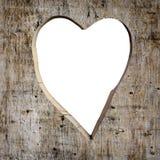 La forme de coeur a découpé dans une planche Photo stock