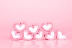 La forme de coeur de guimauve sur le fond rose avec le concept d'amour Photos libres de droits