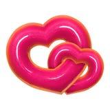 La forme de coeur de deux beignets avec la vue de face vitrée rose a isolé le fond blanc avec le chemin de coupure Jour de valent photographie stock libre de droits