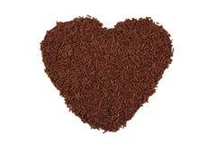 La forme de coeur formée avec du chocolat arrose Images stock