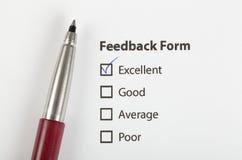 La forme de feedback a contrôlé avec excellent Photos stock