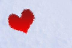 La forme du coeur sur la neige Photos stock