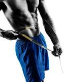 La forme physique de mesure de hanches de bande d'homme exerce la silhouette Images libres de droits