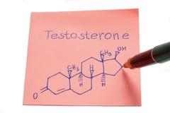 La formula della struttura chimica del testosterone scritta sopra ricorda la nota fotografia stock