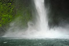 La Fortuna Waterfall pounds down to create a cooling mist. stock photos