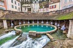La fosse Dionne - the spring in the center of Tonnerre. La fosse Dionne - the karst spring located in the center of Tonnerre, France Royalty Free Stock Image
