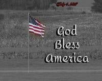 La foto de una bandera coloreada con un fondo blanco y negro y dios del ` de las palabras bendicen el ` de América añadido junto  Fotografía de archivo