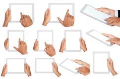 La foto de una tableta se sostuvo al lado de dos manos Fotografía de archivo libre de regalías