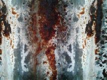 La foto ha arrugginito fondo e struttura del piatto del ferro di strati dello zinco meta fotografia stock libera da diritti