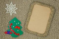 La foto pagina il tessuto tricottato filato intrecciato della iuta sui precedenti Fotografia Stock