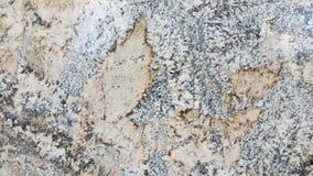 La foto texturizó la superficie del mármol manchado con las rayas multicoloras Fotos de archivo
