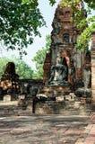 La foto verticale della statua di Buddha nella meditazione Fotografie Stock
