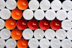 La freccia delle candele multi-colored Immagini Stock