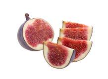 La fruta cortó en segmentos un higo, aislado. Fotos de archivo libres de regalías