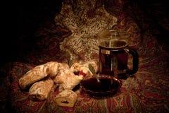 La frutta agglutina con tè Immagini Stock