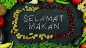 La frutta indonesiana makan di Selamat ferma il moto, in inglese il appetit di Bon Fotografie Stock
