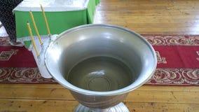 La fuente bautismal Imagenes de archivo