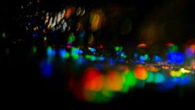 La fusée colorée de lentille entoure des lumières de nuit se reflètent clips vidéos