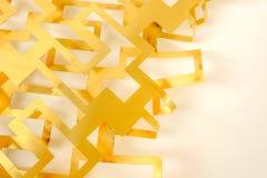 La géométrie de coupe de feuille en laiton sur le fond blanc photo libre de droits