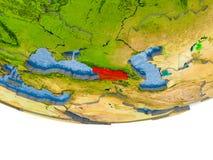 La Géorgie en rouge sur le modèle de la terre Photographie stock
