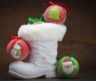 La gaine de Santa avec l'ornement Photographie stock