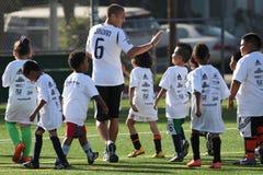 LA Galaxy Soccer Clinic in Pasadena. PASADENA, CALIFORNIA, - MAY 16, 2012. The LA Galaxy soccer club participates in a soccer clinic for members of the Villa stock photos