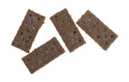 La galleta de Graham del chocolate junta las piezas en un fondo blanco Imágenes de archivo libres de regalías